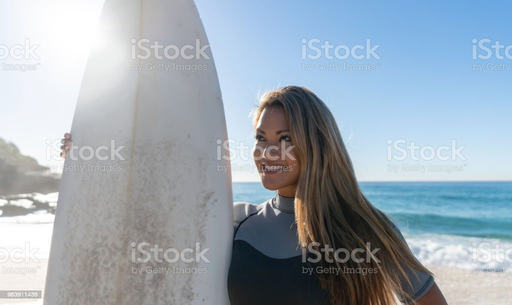Female surfer at the beach looking very happy - Royalty-free Adult Stock Photo