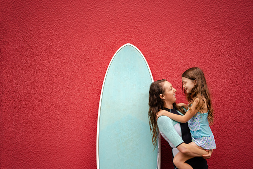 Women in surf culture. Independent female surfer. Female lifestyle images.