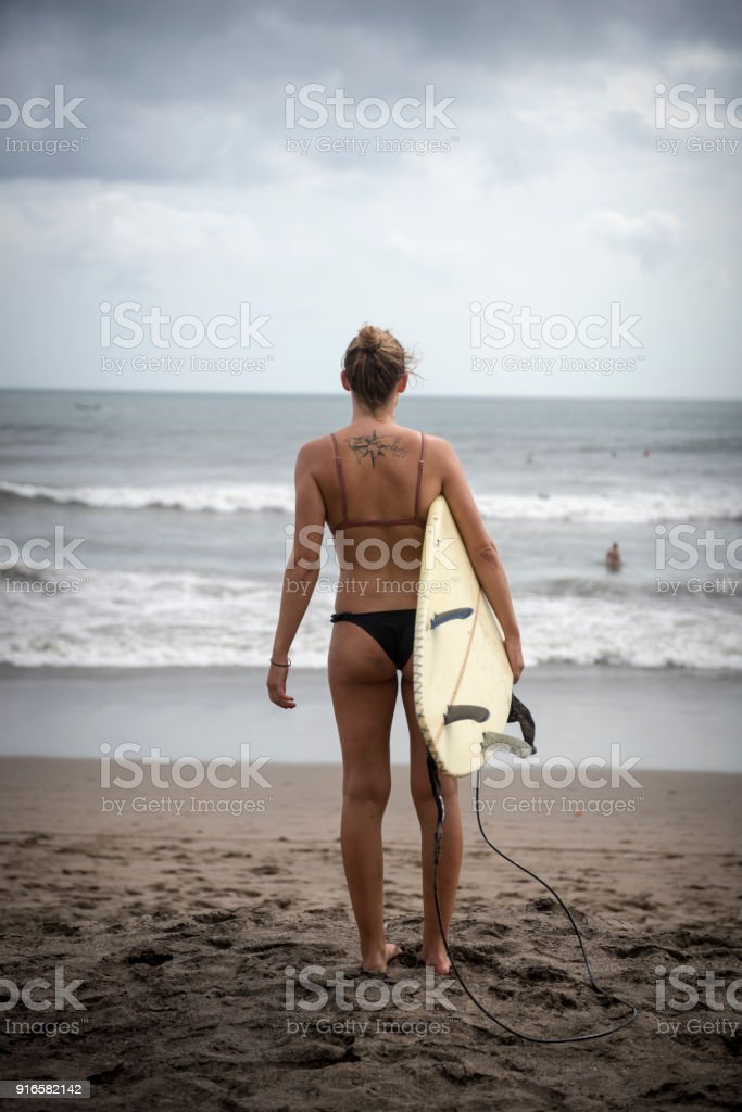 Female surfer with tattoo of world map in bali stock photo more female surfer with tattoo of world map in bali royalty free stock photo gumiabroncs Images