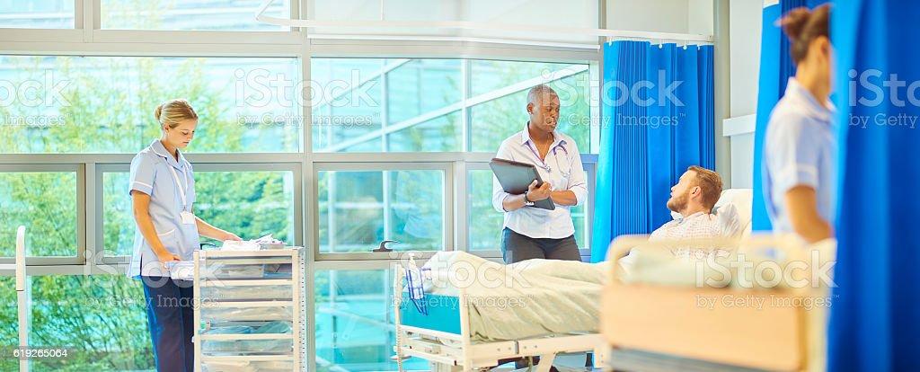 female surgeon explaining procedure stock photo