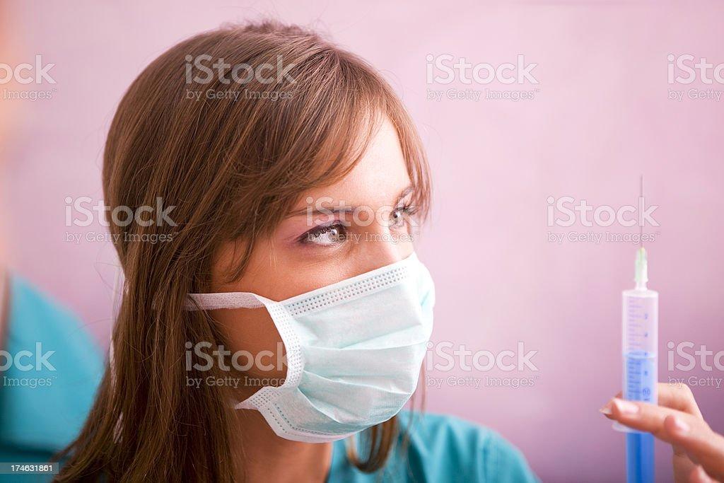 Female surgeon with syringe  XXL royalty-free stock photo