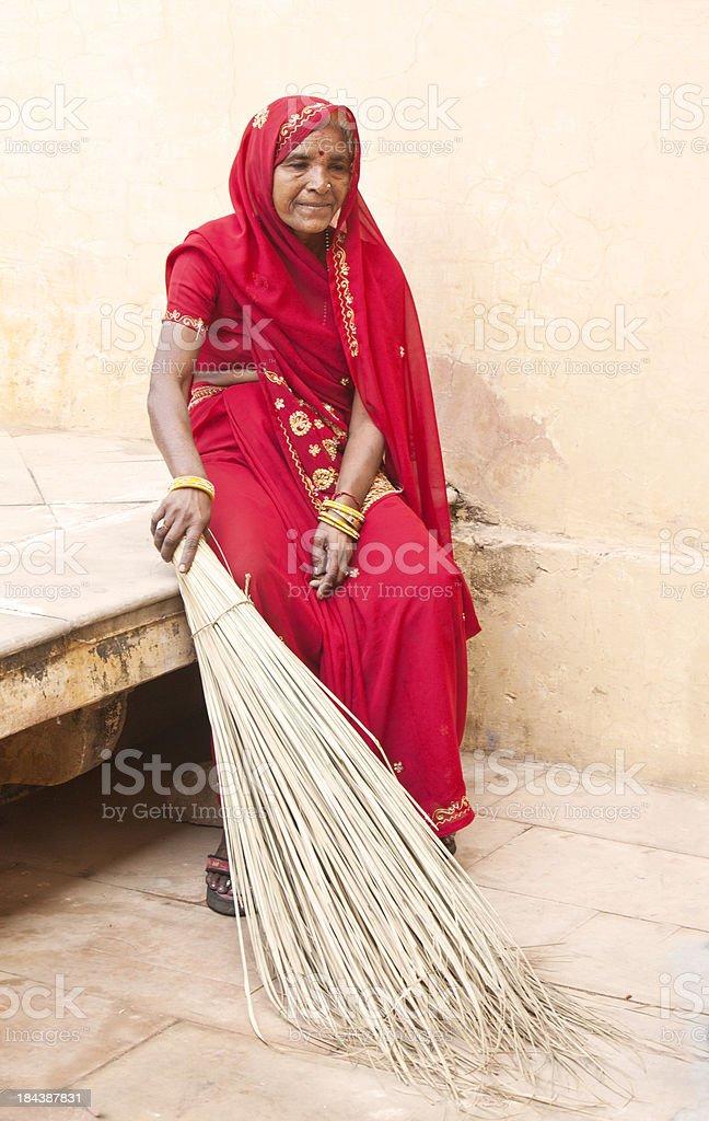 Female Sweeper In Red Sari Resting At Jaipur Fort India
