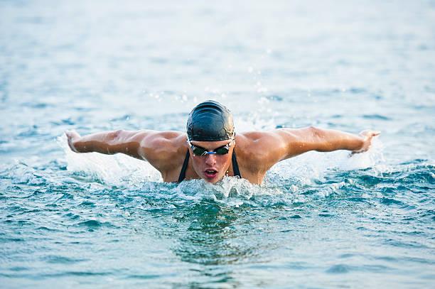 Female swimmer at butterfly stroke in the sea picture id125145097?b=1&k=6&m=125145097&s=612x612&w=0&h=lkiwuvblkhderrdtcx05e981yrfl2i1ukku hcdqudq=