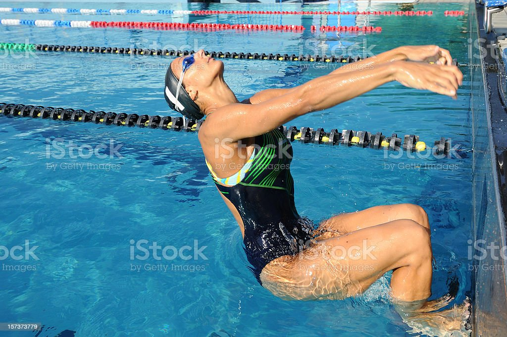 Female swimmer starting stock photo