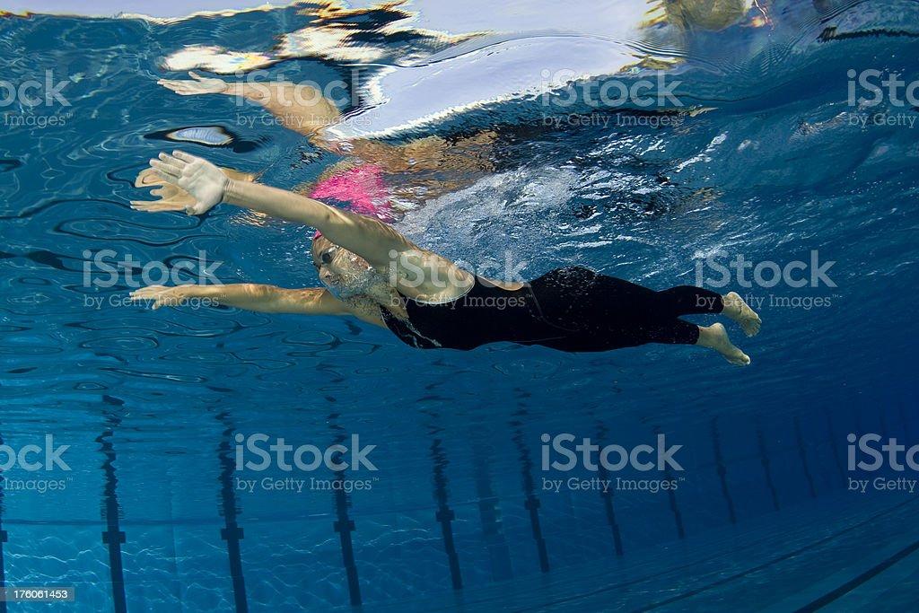 Female swimming underwater stock photo