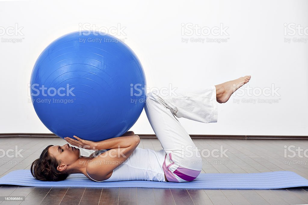 Female take excercise with fitness ball royalty-free stock photo