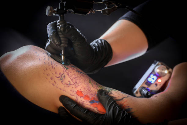 Closeup To Girls Tattoo High-Res Stock Photo - Getty Images
