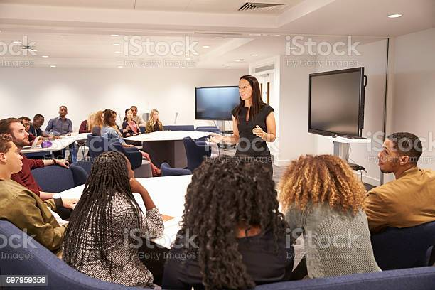 Female teacher addressing university students in a classroom picture id597959356?b=1&k=6&m=597959356&s=612x612&h=bfpe7bfnrzgtrornlzl1pw2 p8dwot0vin9jlejbvqk=