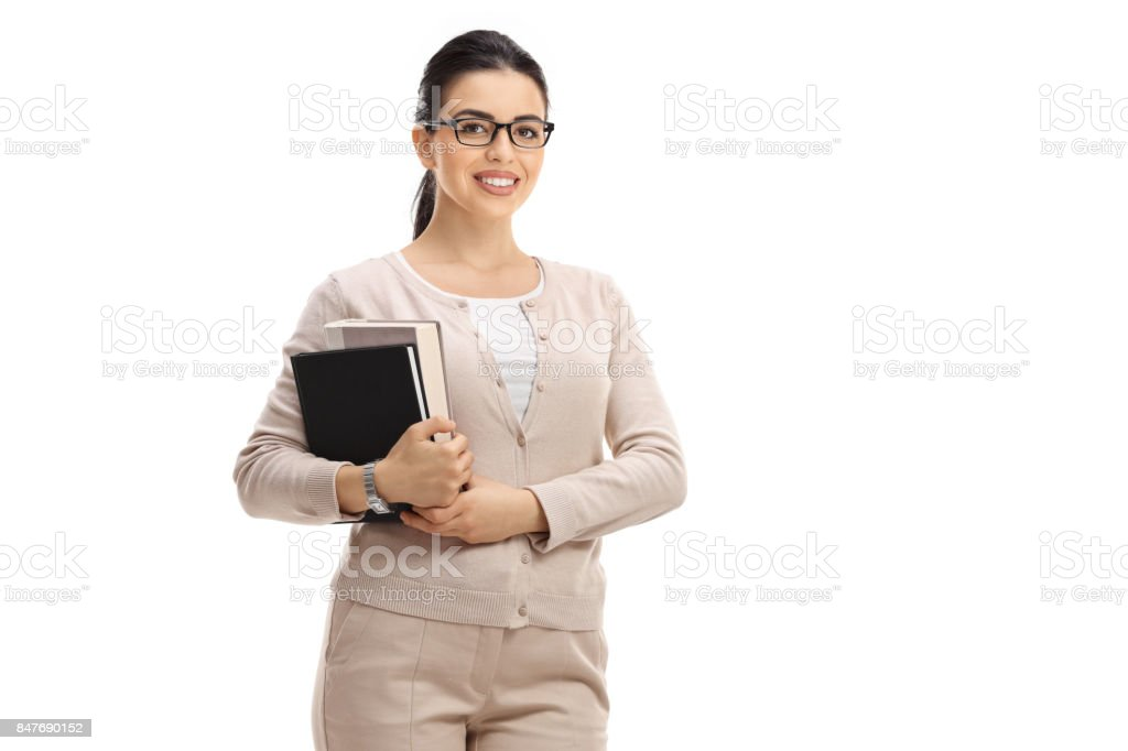 Female teacher looking at the camera and smiling stock photo