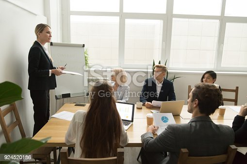 1085713886istockphoto Female team leader discussing corporate plan at multiracial team meeting 924520186