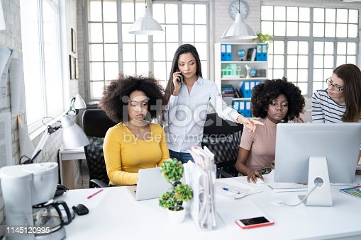 istock Female team working in modern office 1145120995