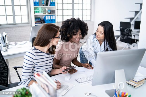 istock Female team working in modern office 1145120997