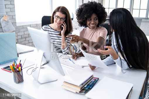 istock Female team working in modern office 1146790711