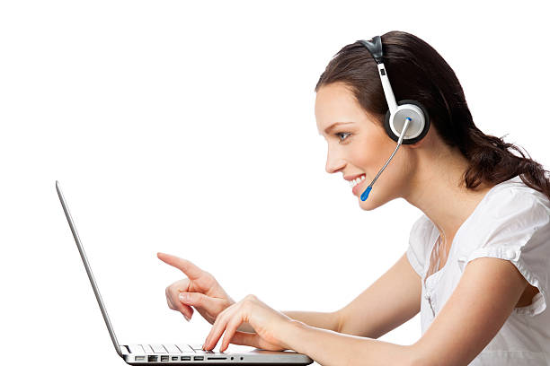 Female technical support worker helping a client stock photo