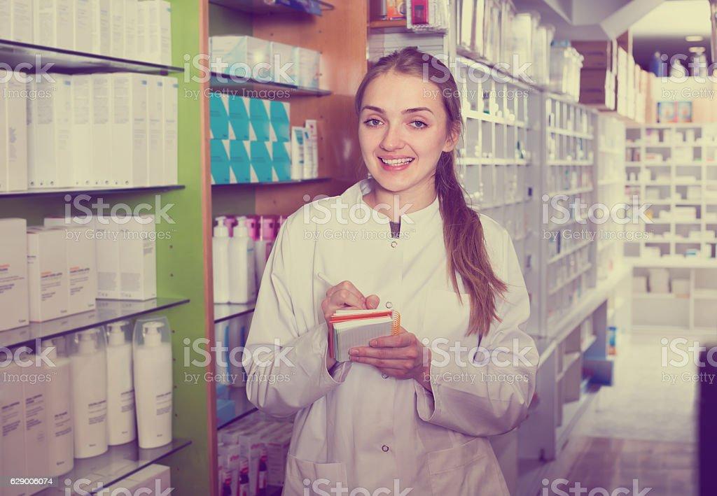 Female technician in chemist shop stock photo