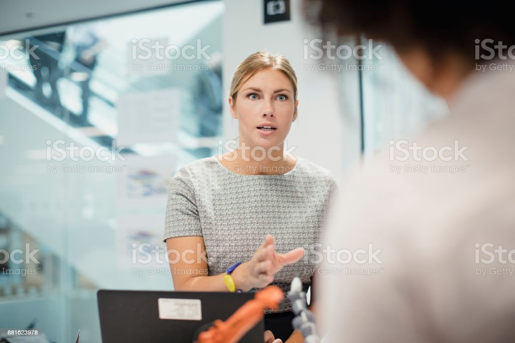 Female Technician in Control of a Meeting stock photo