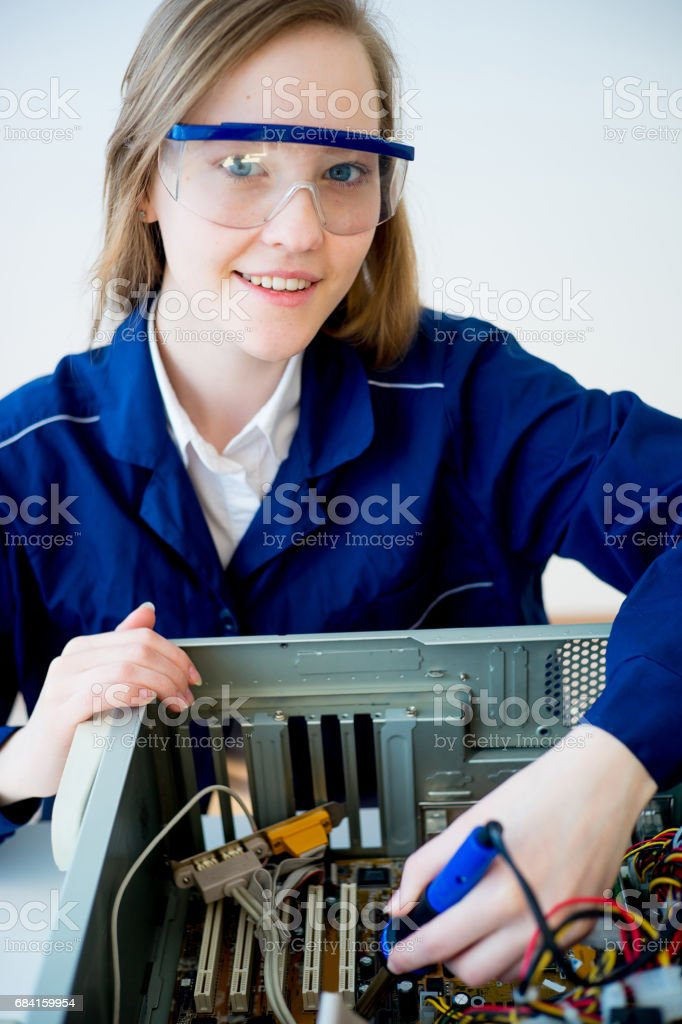Female technician repairing a computer royalty-free stock photo