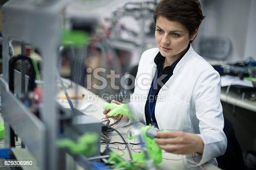 865186916 istock photo Female technician using a 3D printer 629306980