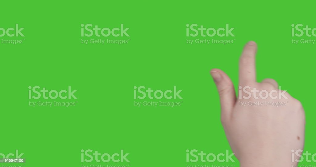 female teen hand 14 drag or flip gestures for tablet pc or smartphone keyed on green screen stock photo