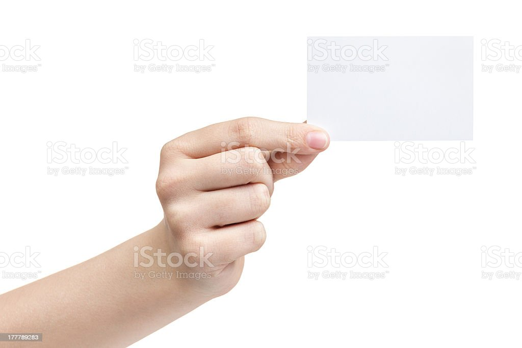 female teen hand holding blank paper card with two fingers royalty-free stock photo