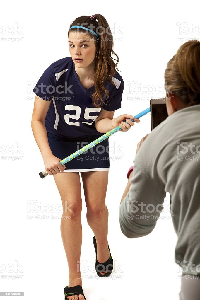 Female teen in lacrosse outfit posing and looking at photographer royalty-free stock photo