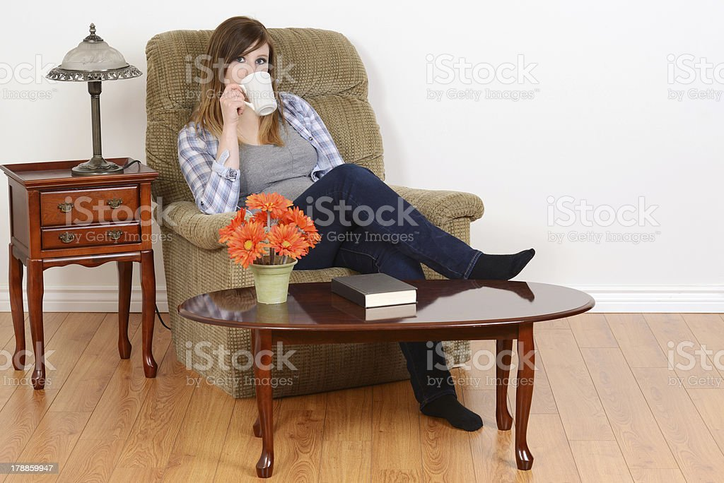 female teen relaxing with a coffee royalty-free stock photo