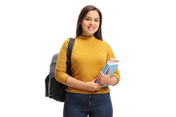 female teen student with a backpack and books smiling - scolara foto e immagini stock