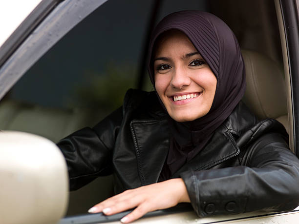 Female teenage muslim driver stock photo