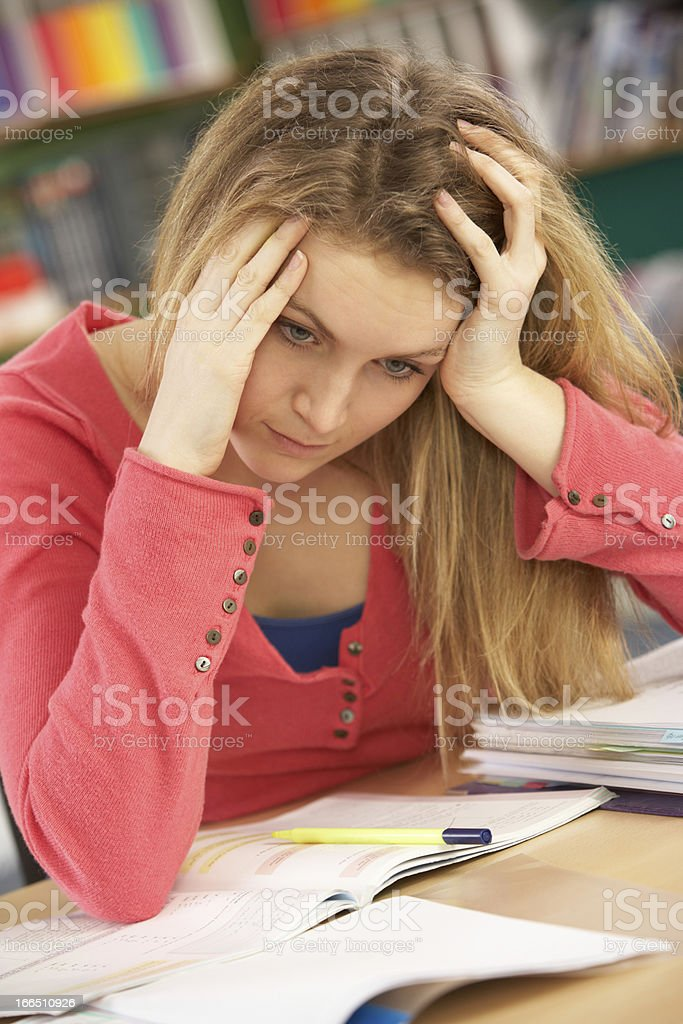 Female Teenage Student Studying In Classroom royalty-free stock photo