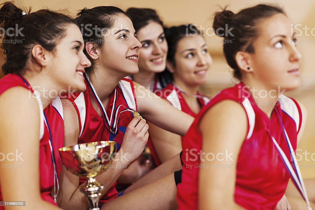 Female teenage volleyball team with gold medals. royalty-free stock photo