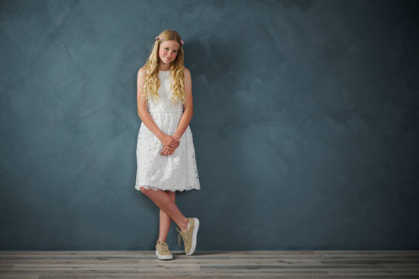 Female teenager  in traditional confirmation dress stock photo