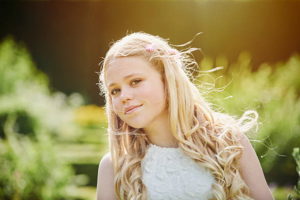 Female teenager  in traditional religious confirmation dress stock photo