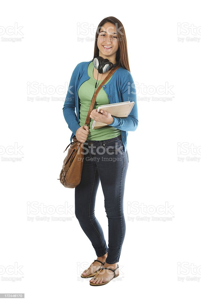 Female teenager with school stuff and headphones, isolated on white royalty-free stock photo