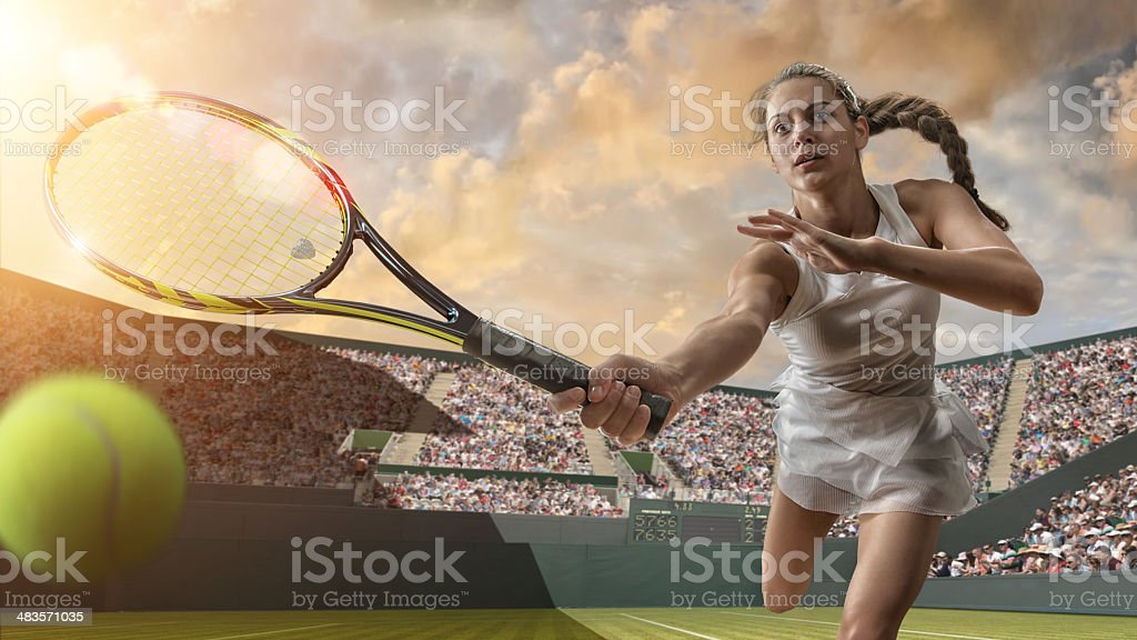 Female Tennis Player About To Strike Ball stock photo