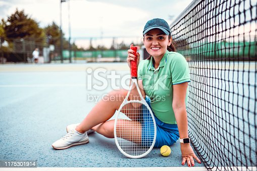 emale Tennis Player Enjoying Her Day At The Tennis Court