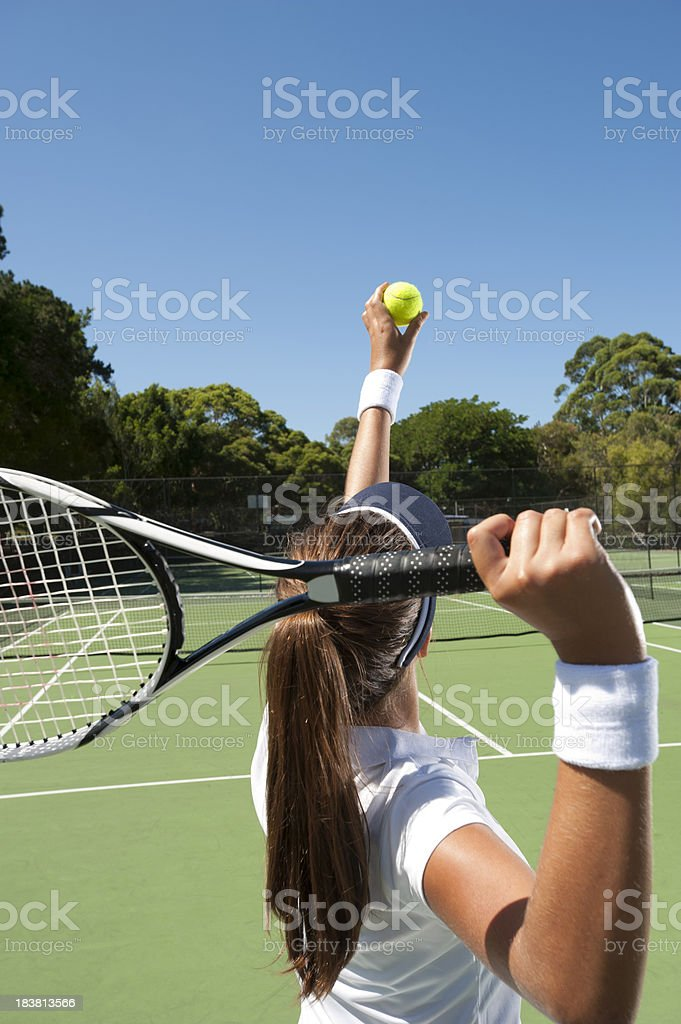 Female tennis player getting ready to serve. royalty-free stock photo