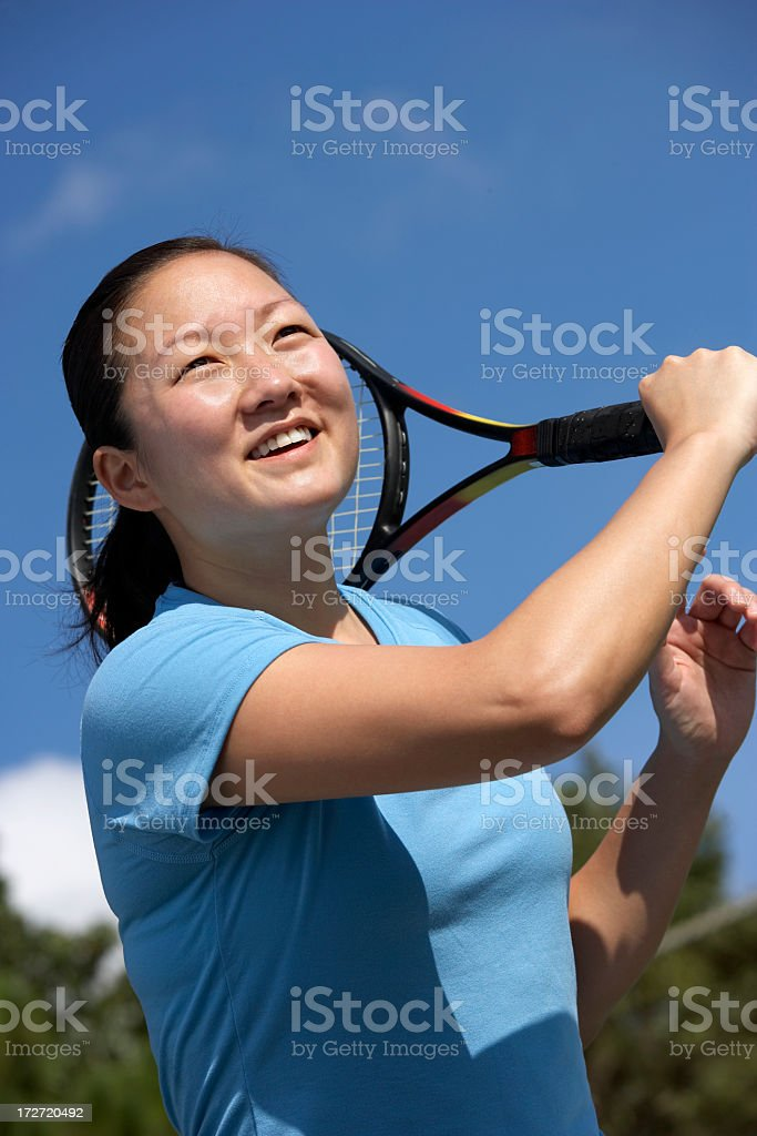 female Tennis player hitting a forehand winner royalty-free stock photo