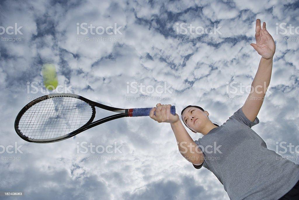 female tennis player hitting forehand stock photo