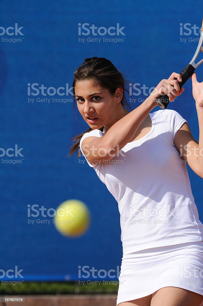 Female tennis player hitting the ball at forehand royalty-free stock photo