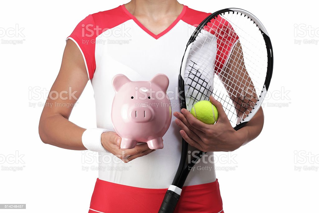 female tennis player holding a piggy bank stock photo