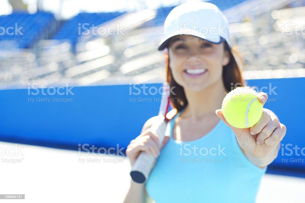 Female Tennis Player Holding Ball stock photo