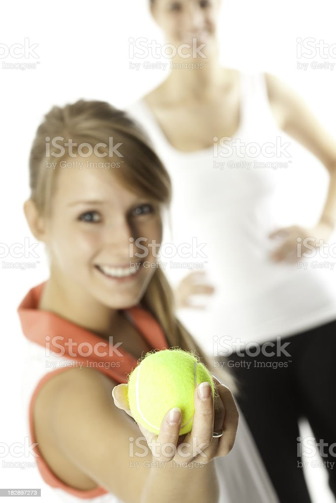Female Tennis Player Holding Out Ball royalty-free stock photo