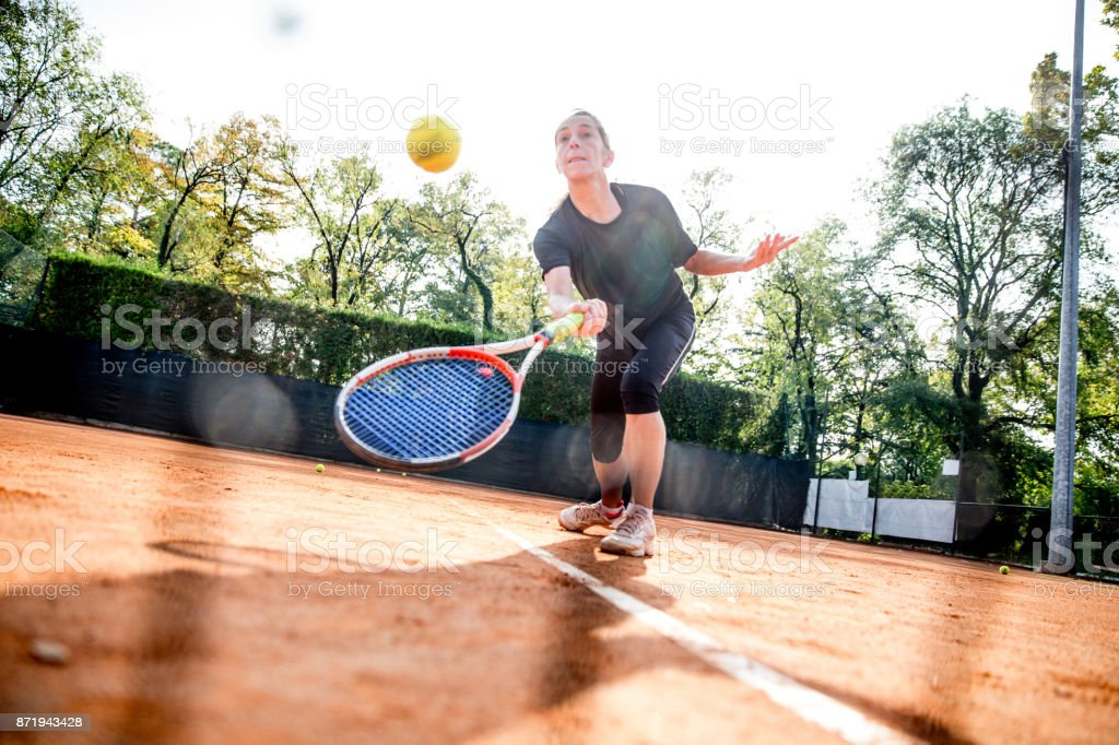 Female Tennis Player In Action stock photo