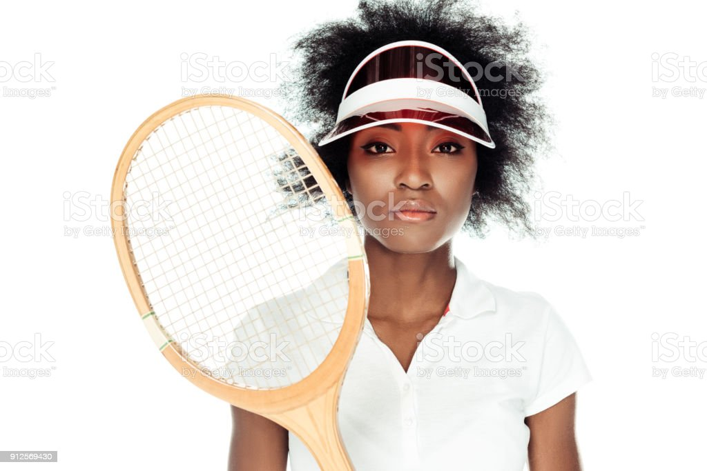 female tennis player in cap with racket isolated on white stock photo