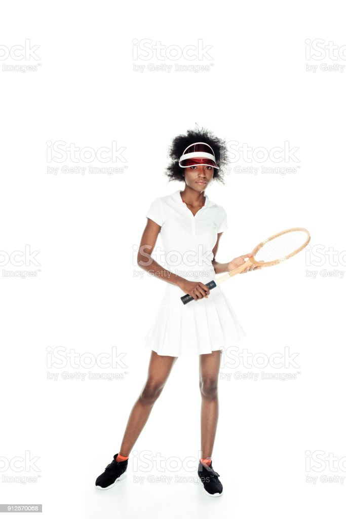 female tennis player in white sportswear with racket isolated on white stock photo