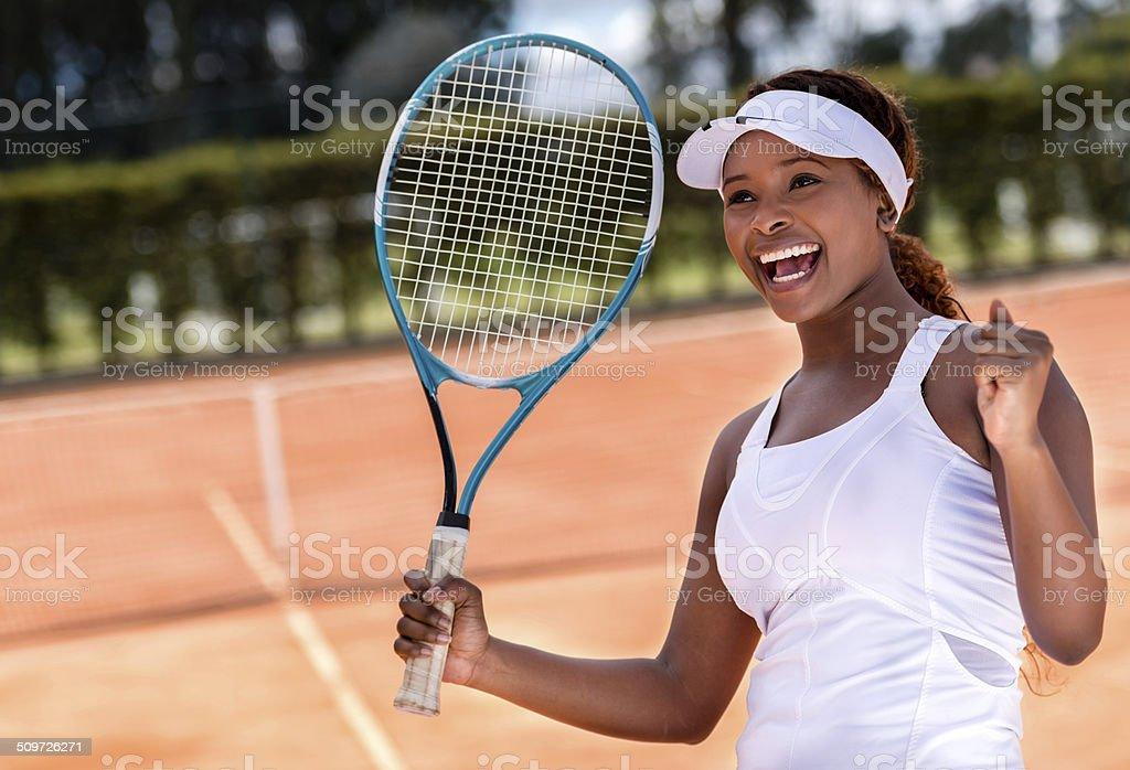 Female tennis player winning stock photo