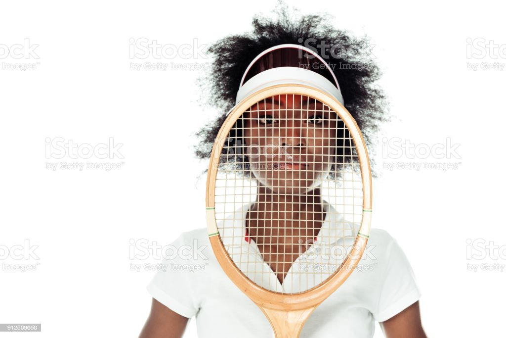 female tennis player with racket in front of face isolated on white stock photo
