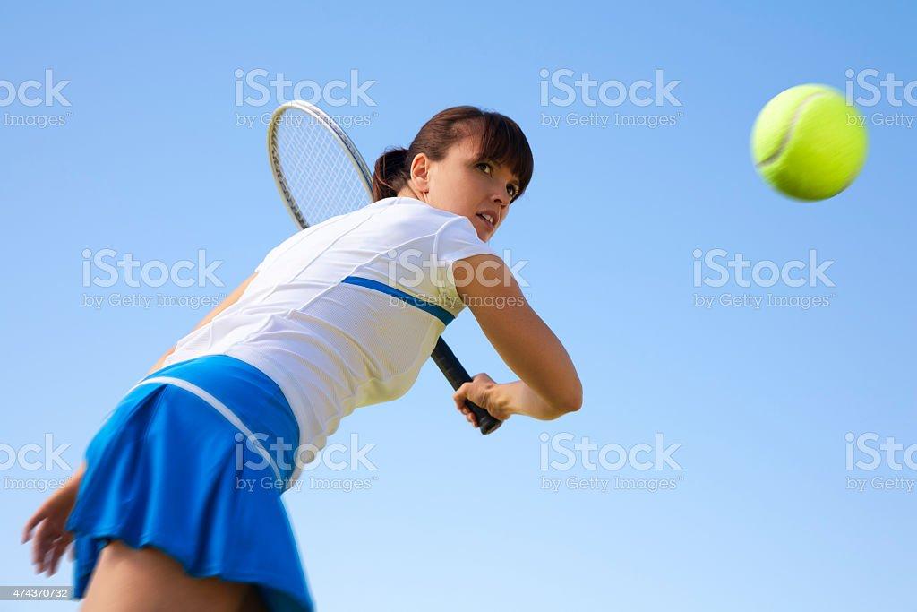 Female TennisPlayer Focused in Action stock photo