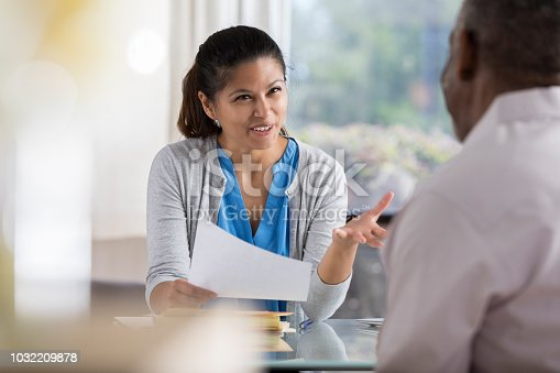 istock Female therapist explains strategy to new patient 1032209878