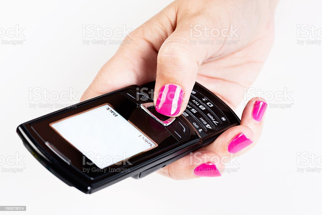 Female thumb pressing button on blank-screened mobile phone royalty-free stock photo